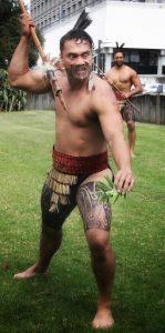 HAKA WORKSHOPS: Māori warrior with taiaha on marae showing off his skills