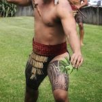 HAKA WORKSHOPS: Māori warrior with taiaha on marae showing off his skills